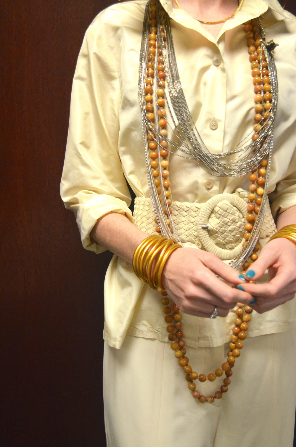 A gold torque, strand necklaces and budhabeads coexist.