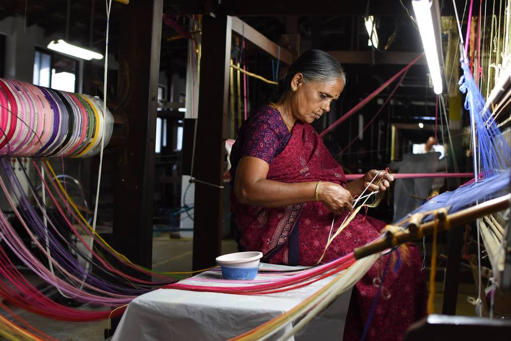 Artisans thoughtfully weaving organic cotton