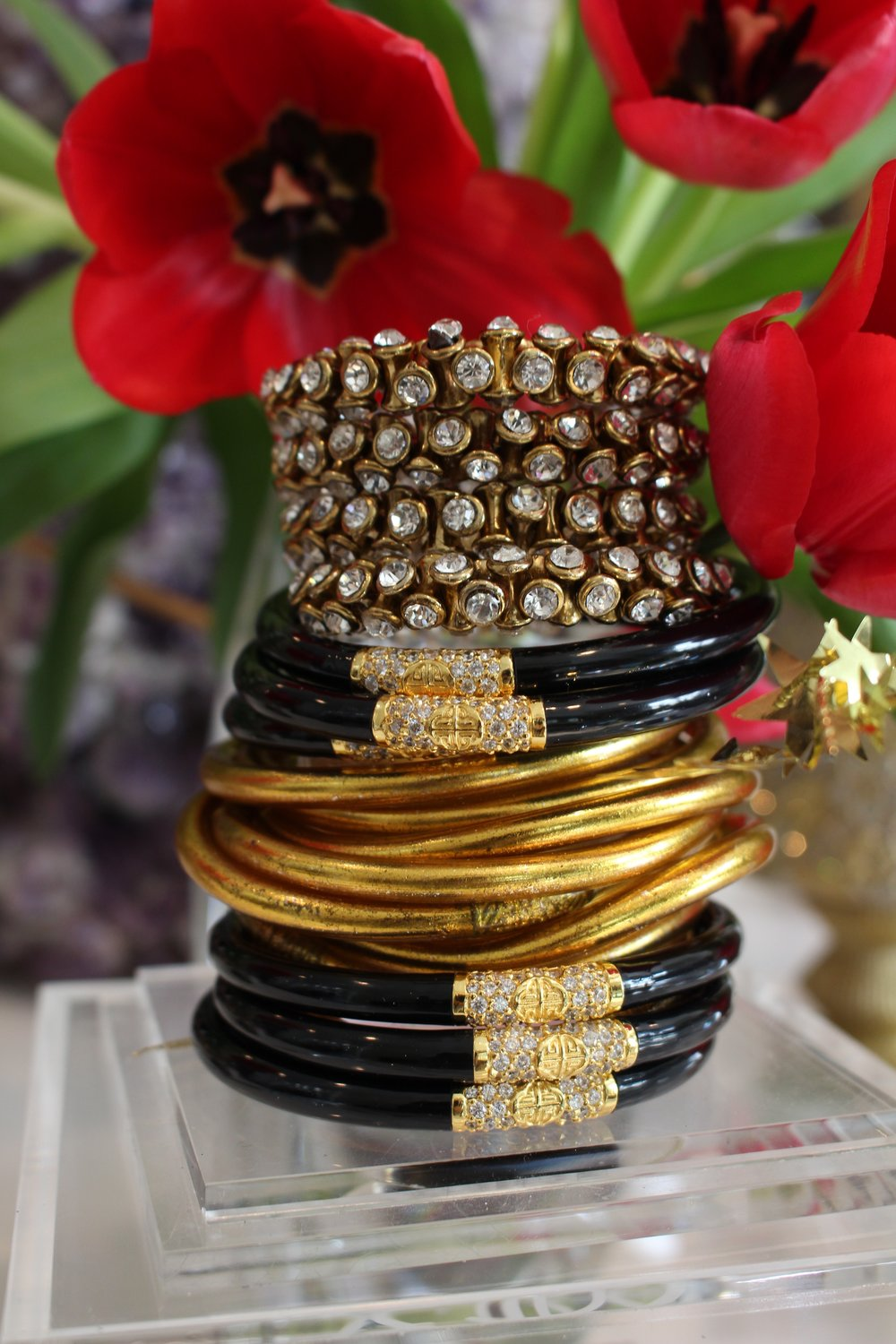 Gold All Weather Bangles ,  Black All Weather Bangles  and a  Crystal Wrap Bracelet
