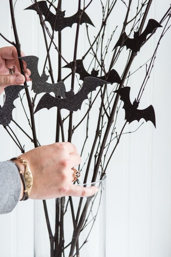 Affix bat silhouettes to a dried arrangement, or suspend them from the ceiling for extra dimension.