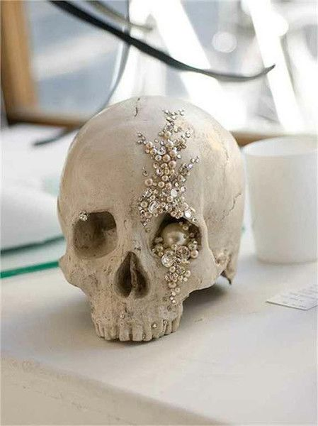 Put a feminine spin on your party with a little sparkle - bedazzled skulls anyone?