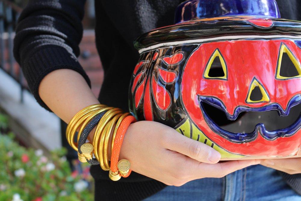 Beautiful, painted ceramic jack o'lantern paired with orange and black  Stingray Wrist Wraps .