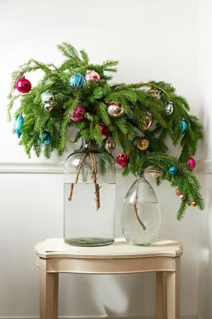 Want to decorate a lonely corner? Try a few branches embellished with ornaments!