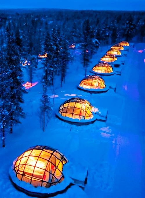 Experience the Northern Lights from inside a glass igloo.  Kakslauttanen  is an enchanting arctic resort in Finland that's 250km north of the Arctic Circle. When you're not watching the incredible Northern Lights or Midnight Sun, enjoy skiing, snowboarding, husky safaris and snowmobiling. You may see a few reindeer, too!