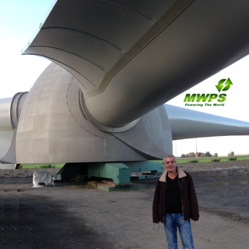 MWPS World & Hitwind Director Ralph Ruppert at a repowering project in Germany. In the background visible are the blades of the new Enercon E126 a 7.5MW Turbine