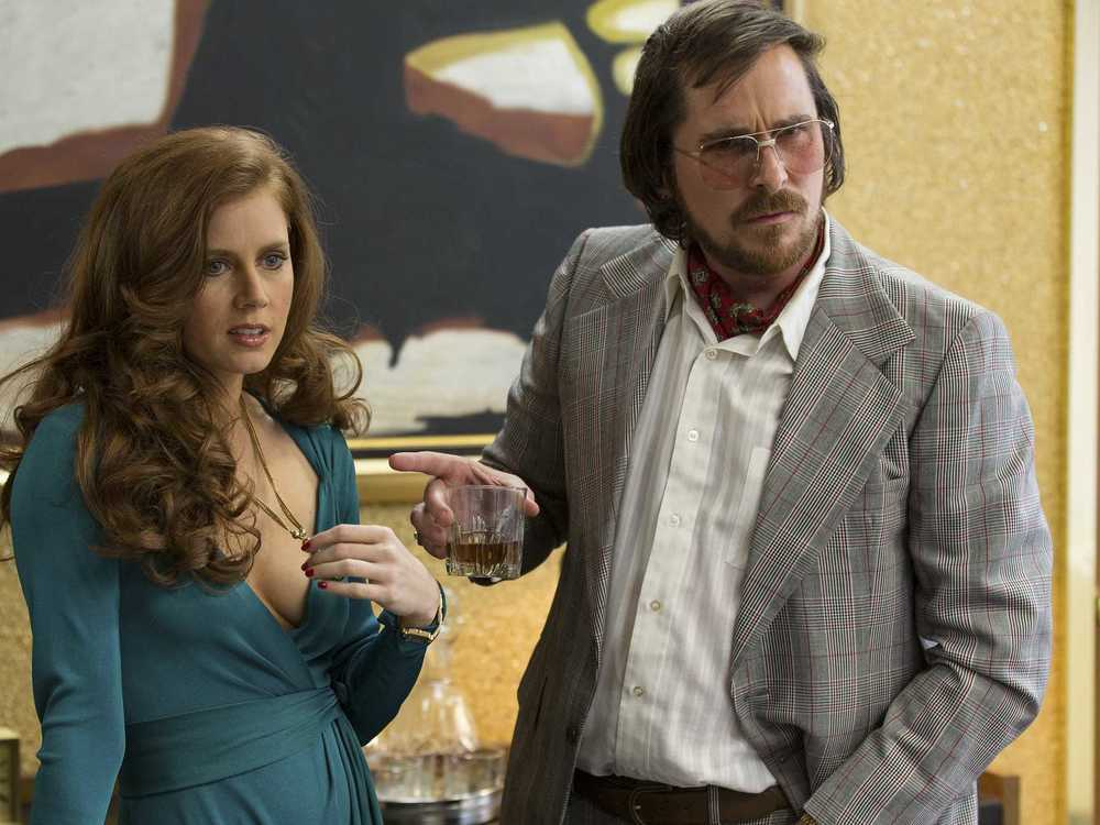christian-bale-and-amy-adams-rock-the-70s-in-new-american-hustle-trailer.jpg