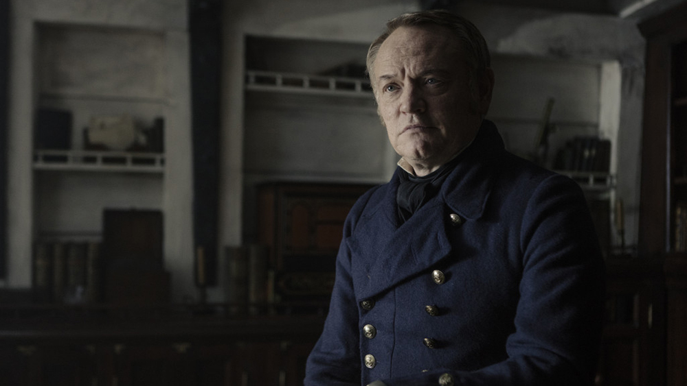 Jared Harris is given the thankless role of the doomed leader of men