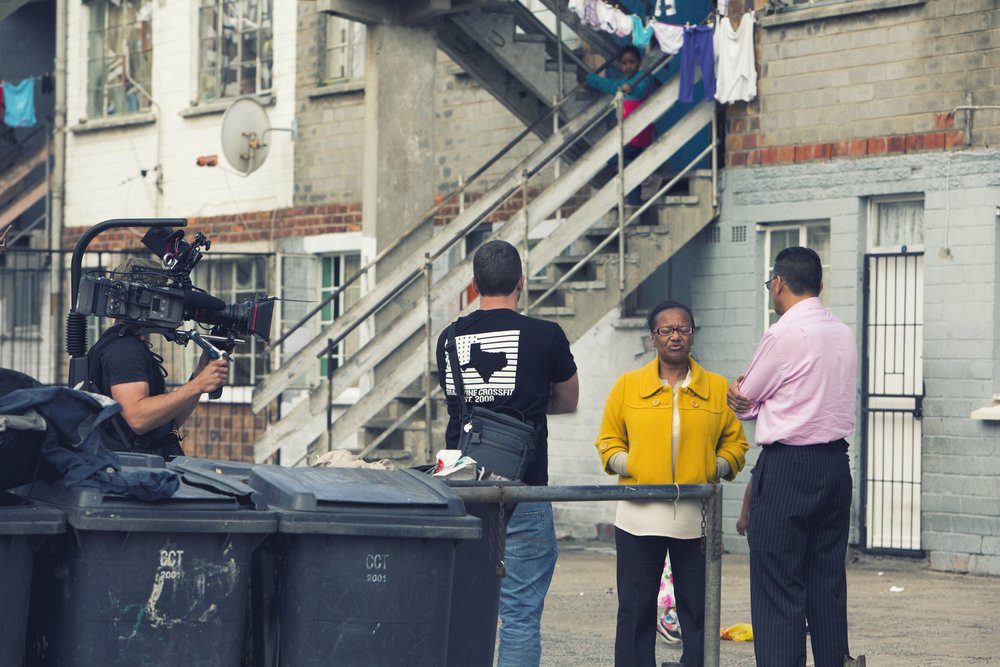 Allan and Dustin interviewing a woman in the Lavender Hill neighborhood of Cape Town, a government housing project where many inmates at Pollsmoor grew up.