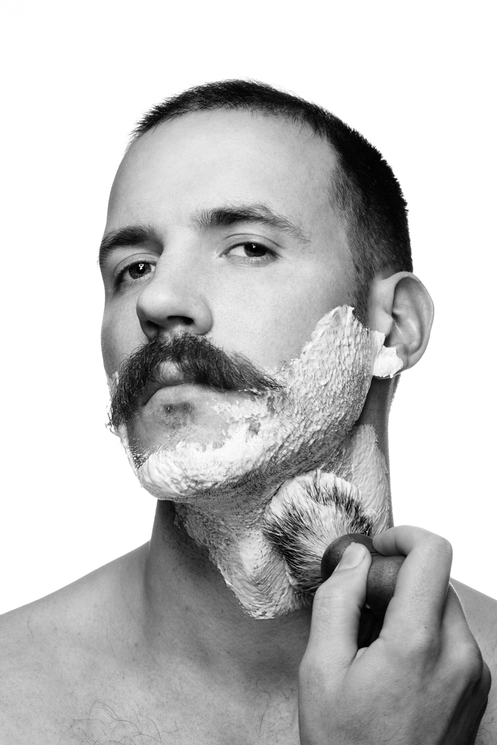 Man on white background, studio photography, black and white portraits, man shaving