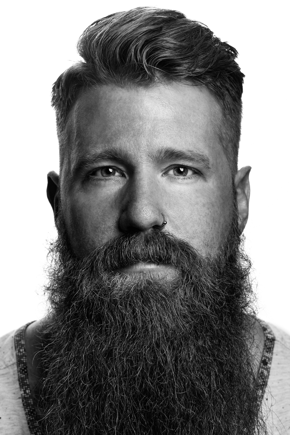 Man on white background, studio photography, black and white portraits, hipster with beard, hipster with tattoos