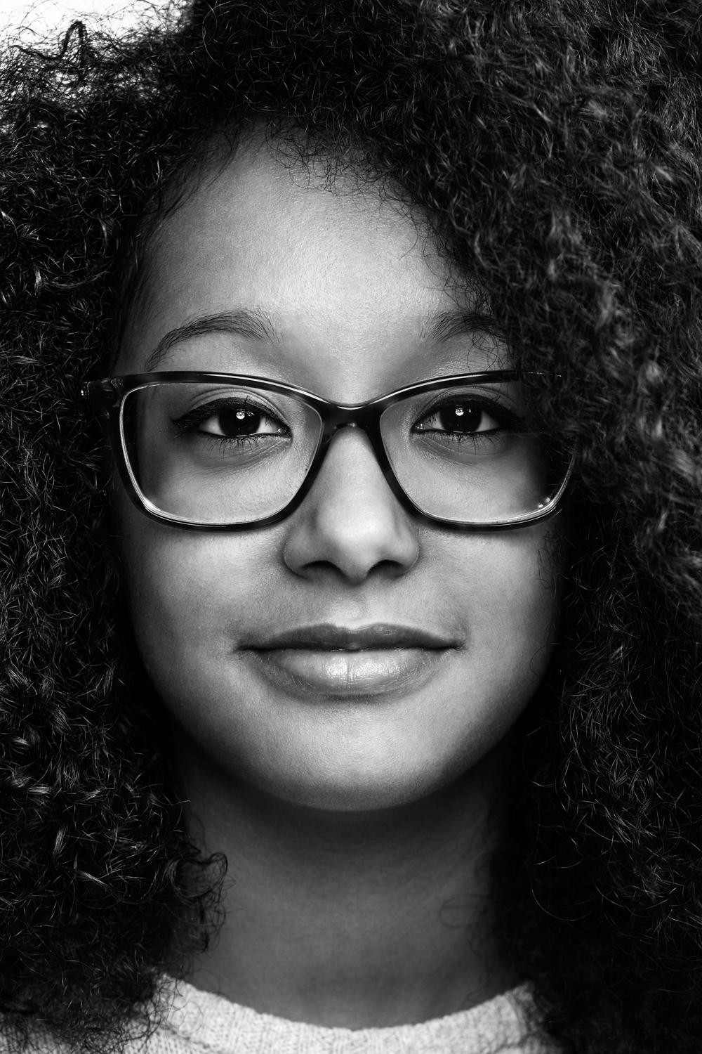Woman on white background, studio photography, black and white portraits, black girl, girl with glasses