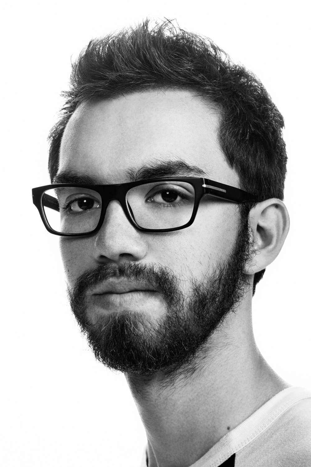 Man on white background, studio photography, black and white portraits, hipster with glasess