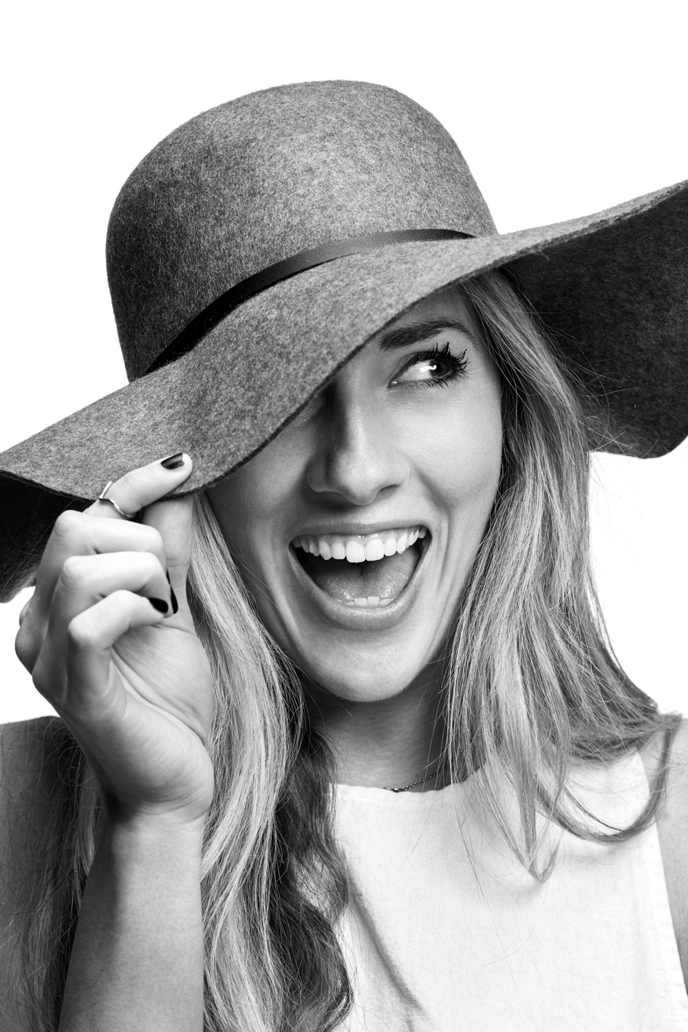 Woman on white background, studio photography, black and white portraits, girl laughing, girl wearing hat