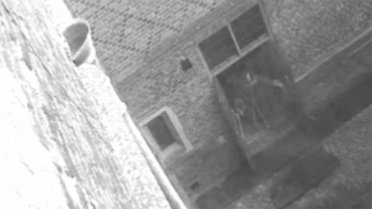 This image was still from a footage caught by the Hampton Court palace's security camera. A ghostly figure appears to be closing the door, but when the guards arrived, they found no one there. The Hampton Court is a royal palace in London. It had a history of violence. The ghost was believed to have been that of the one being reported to haunt the place.  Read More:  http://www.trueactivist.com/worlds-most-mysterious-and-unexplained-photos-gallery/8/