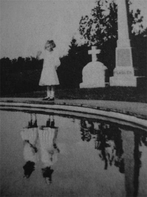 In 1925, the little girl pictured here lost her twin sister in a fire that broke out in their home. But as can be seen in this photograph, it seems that the ghost of her twin had been following her all along.  Read More: http://www.trueactivist.com/worlds-most-mysterious-and-unexplained-photos-gallery/29/