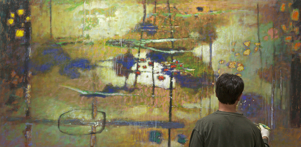 "Rick Stevens works into a new 48 x 96"" painting"