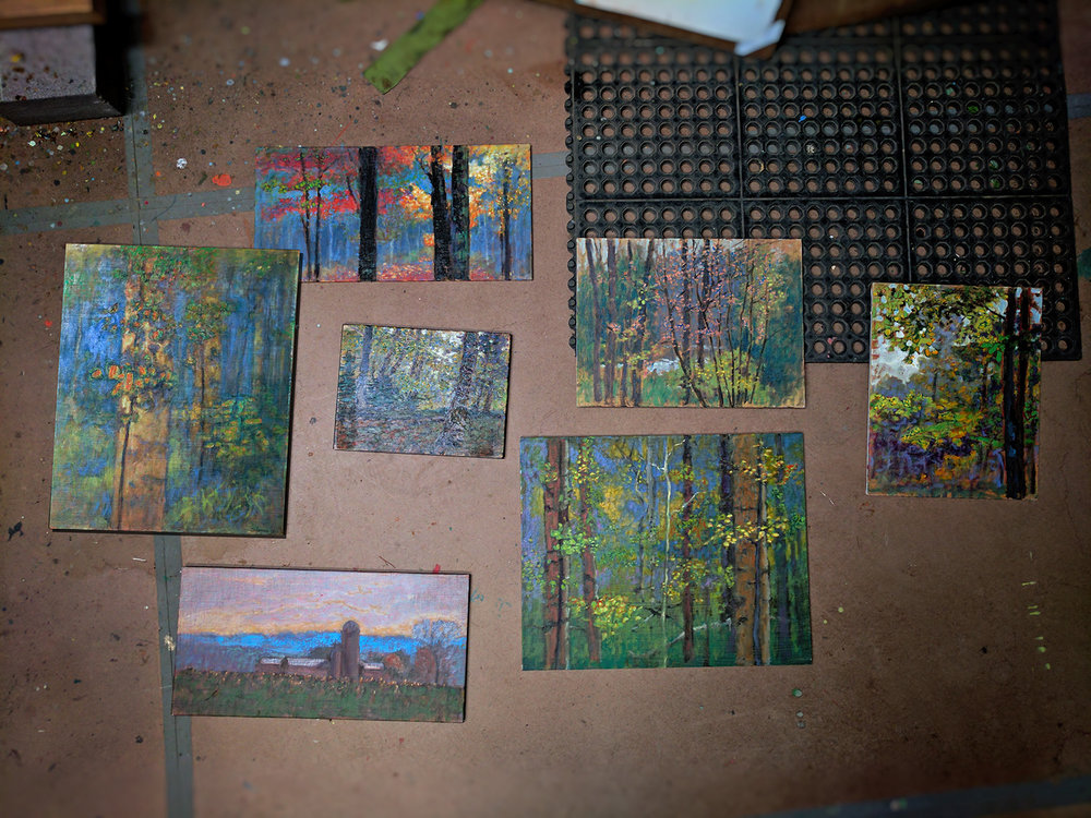 several plein air pieces in progress at the studio