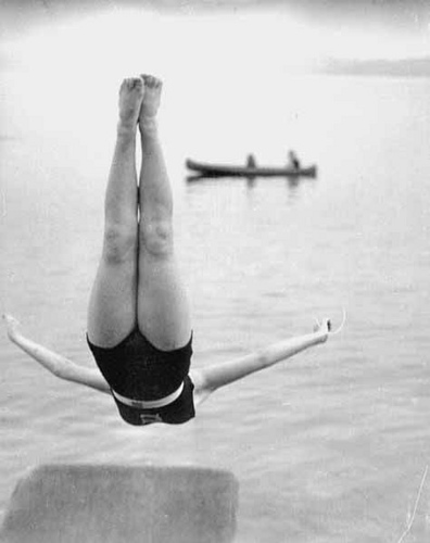 b&w photo of girl diving into a lake