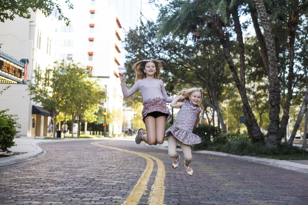 Girls jumping in downtown Tampa Street