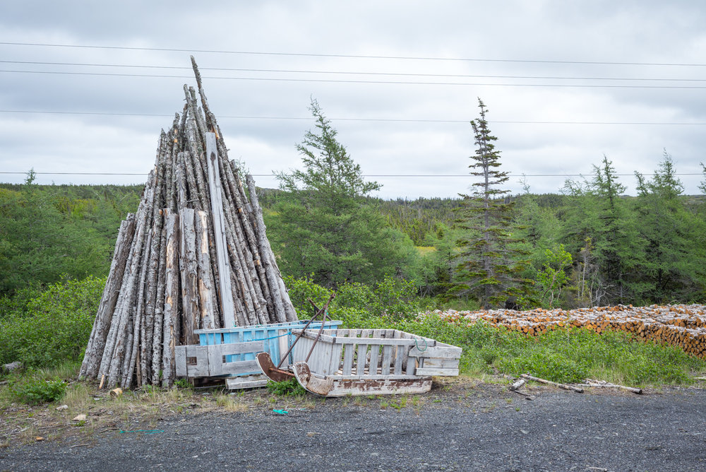 Timber and sleds at the firewood depot. Saint Lunaire-Griquet, Newfoundland 2016