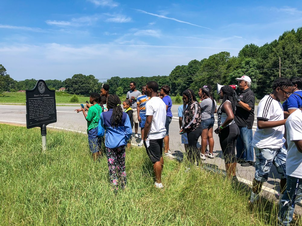 Tyrone Brooks speaks to 200 children from surrounding states who have come to Monroe, GA to visit the Moore's Ford Lynching site. This is one stop of several civil rights sites for the children lead by Minister Williams.