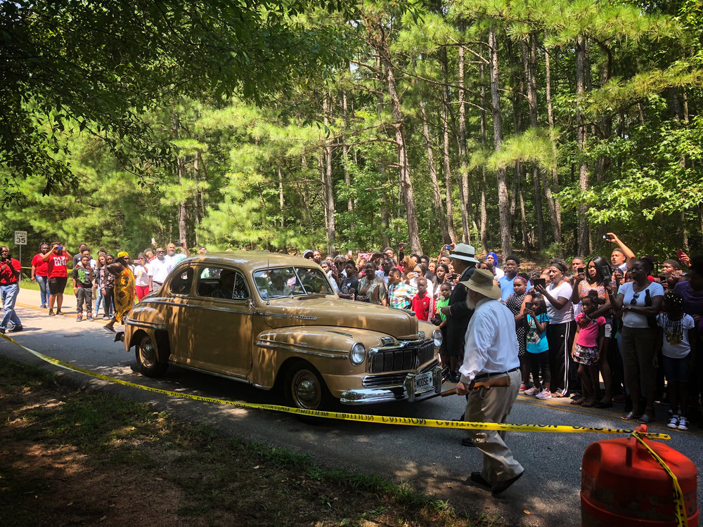 Scene in the Moore's Ford Lynching re-enactment when Loy Harrison drives his car with victims as passengers to the Moore's Ford Bridge where the lynch mob awaits their arrival.