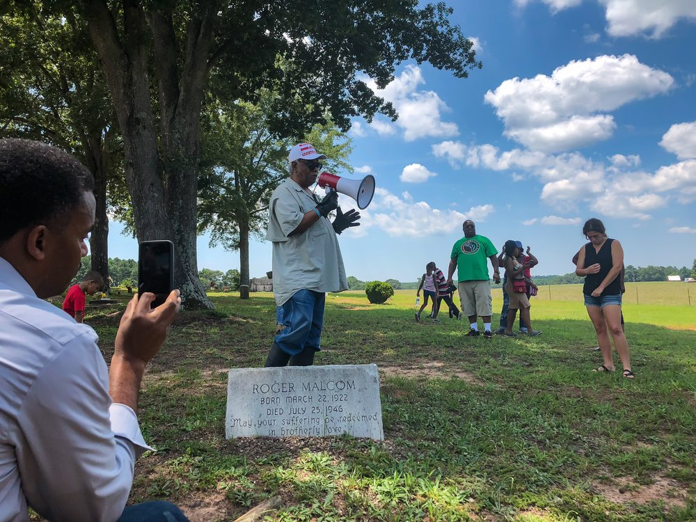 Site of Moore's Ford Lynching victim Roger Malcom's grave at Chestnut Grove Baptist Church in Rutledge, GA. Tyrone Brooks shares the story that lead to his death with attendees. This is one stop of several on the motorcade schedule to visit the victims' graves.