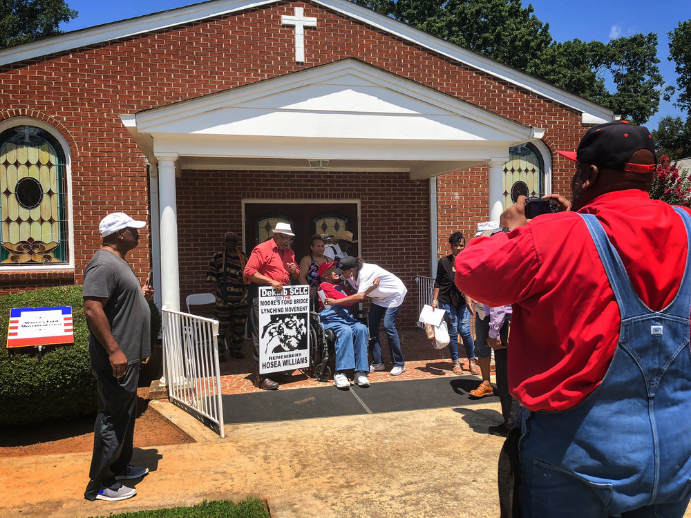 Members and supporters of the Moore's Ford Movement pictured outside of First African Baptist Church in Monroe, GA. This the gathering place for the commemoration, the start of the day-long events.