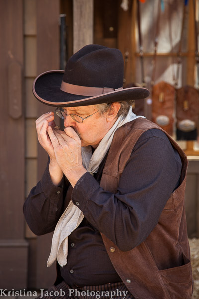 Country entertainer Dave Rainwater plays a tune on his harmonica
