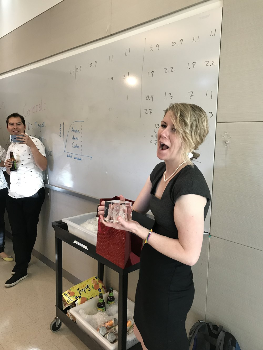 Megan celebrates completing her oral Ph.D. thesis defense! Holding her new power crystal, a gift from the lab. - 13 September 18