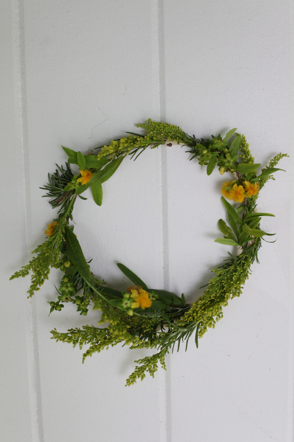 Floral Crown: St. John's Wort, Rosemary, Aster Solidago, and Donkey Tail.