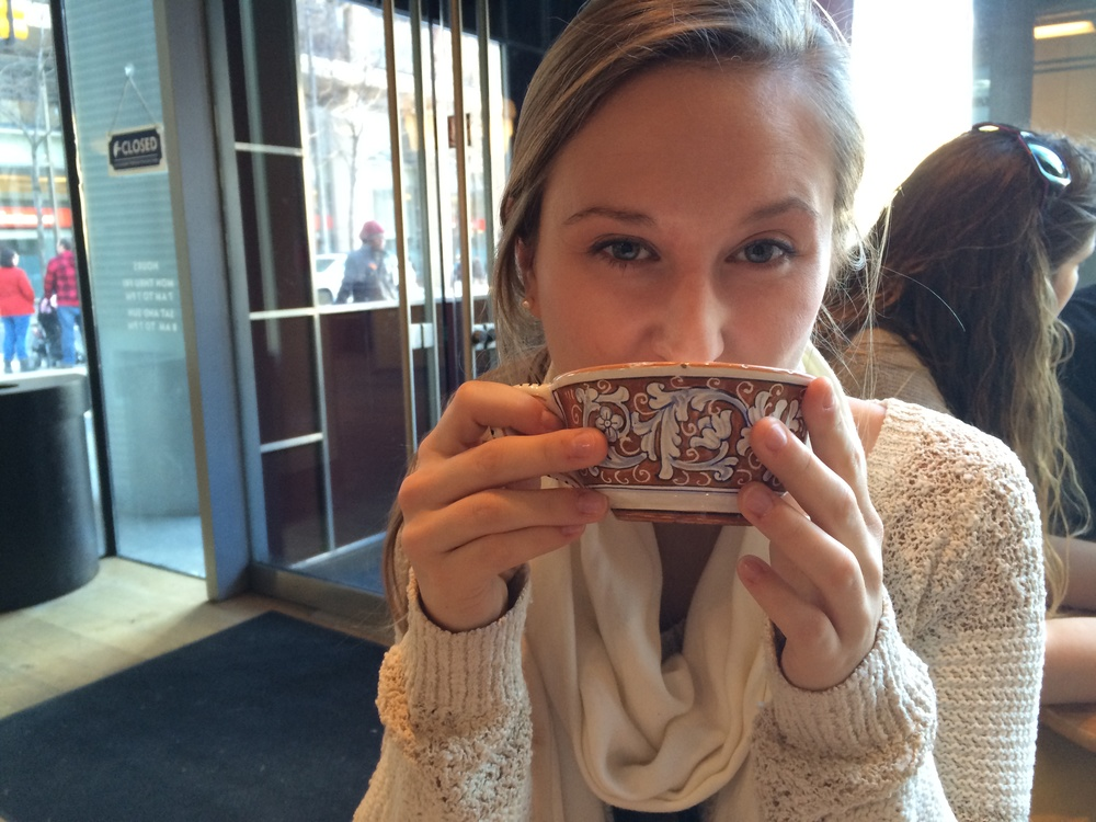 Enjoying a cappucinno at her favorite local coffee shop, La Colombe.