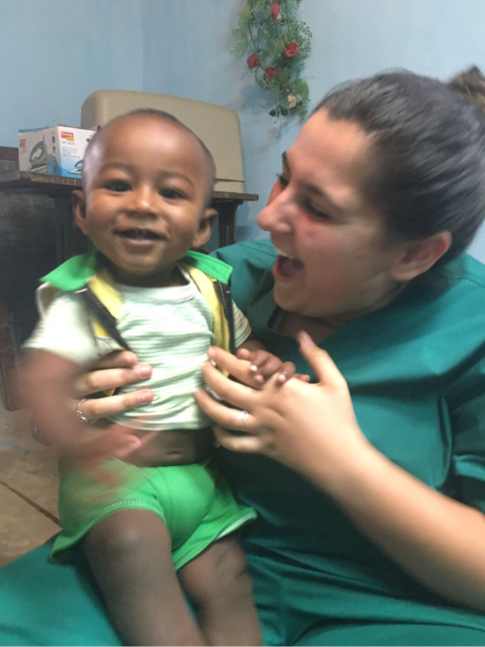 SIHF India  Fellow Erica Rovner with a pediatric patient.