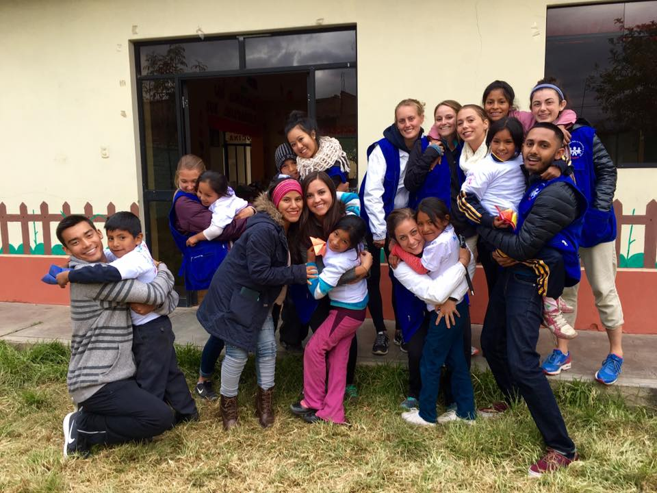 SIHF Huancayo, Peru  Fellows pose for a quick photo with the children participating in the Dale La Mano orphanage education program.