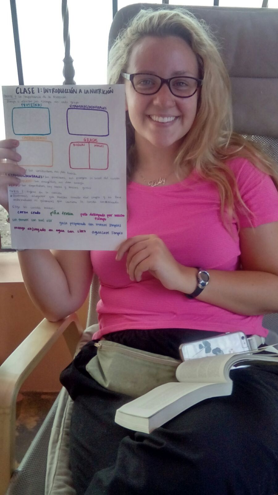 SIHF Dominican Republic  Fellow Libby displays the worksheet she created for the Nutrition Program.