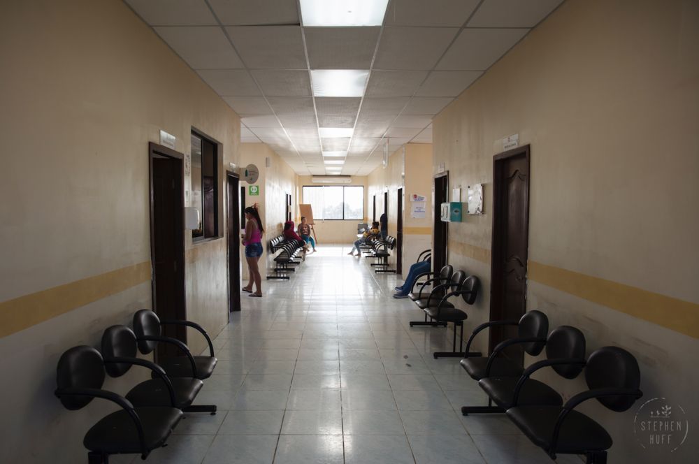 The goal of providing free health services to all Ecuadorians is admirable, but in practice the system is overburdened and underfunded. Because the health center is so understaffed residents must wait months for appointments, and even once they are seen the facility lacks basic supplies and equipment to attend to the needs of its patients. People are regularly sent to the nearest pharmacy to buy basic supplies like gauze, Band-Aids, and syringes for injections. They are prescribed medications that are out of stock at the health center, so they must purchase them themselves. Mothers of newborns must wait months for vaccines to be available to vaccinate their children against deadly diseases.