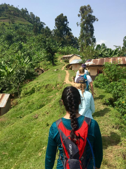 Volunteers hiking in Bududa for health outreach