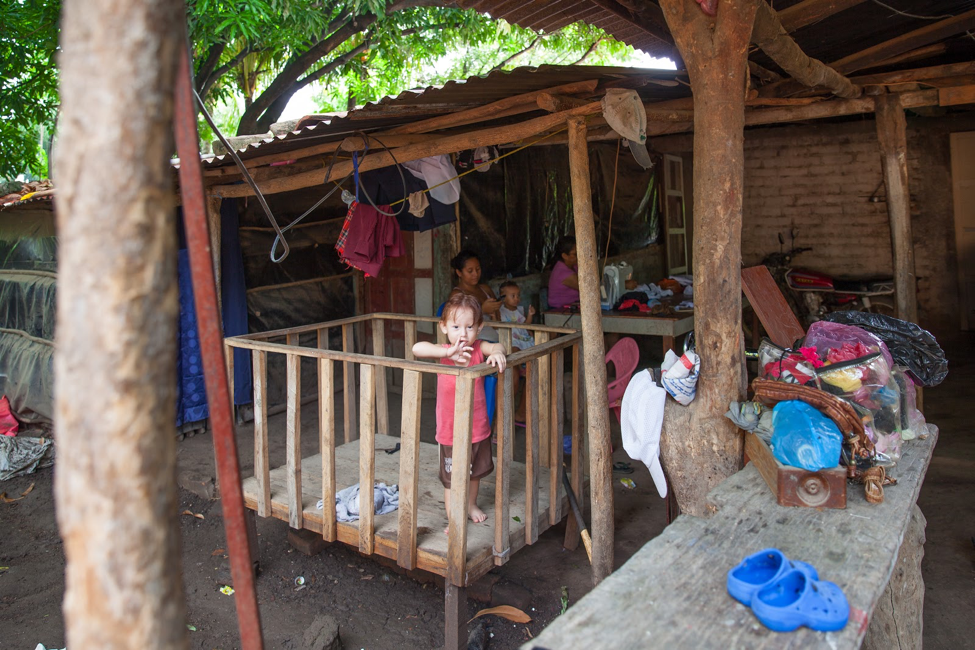 Johan's family is one of our first MHIP participants. The walls of Johan's house are currently made of plastic and the floor is dirt.