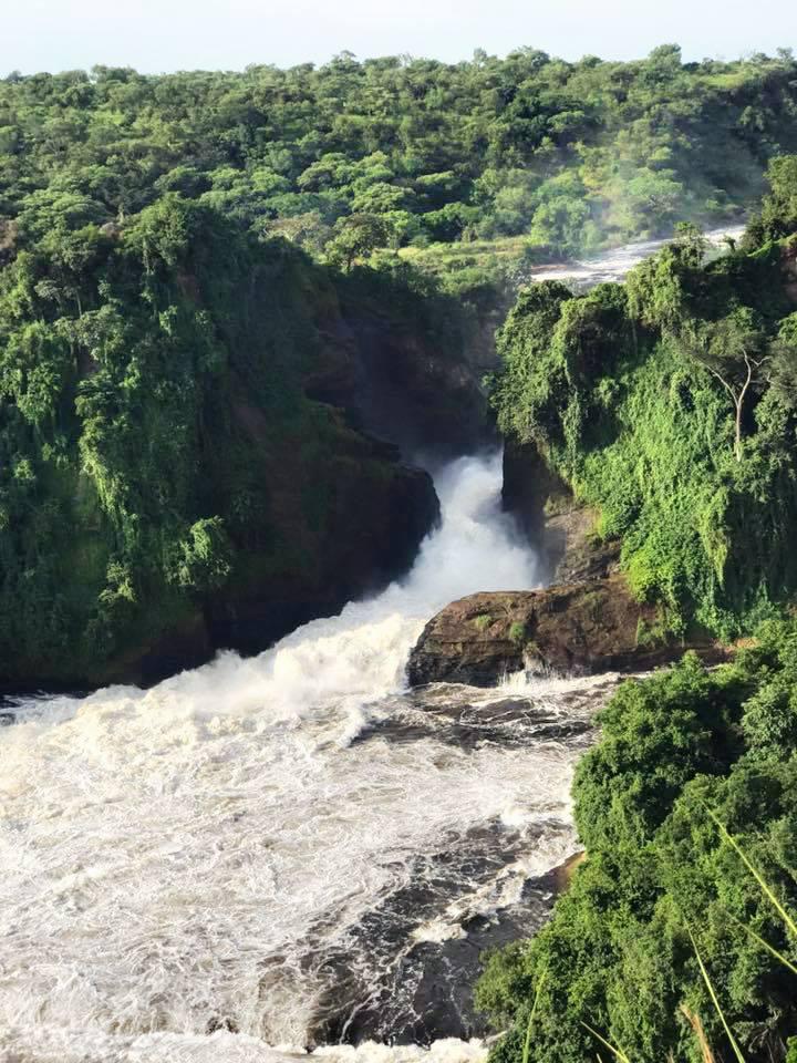 Appreciating waterfalls on the Nile after a safari in Uganda