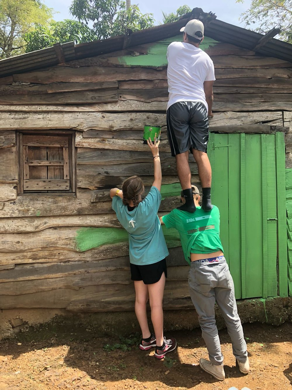 Painting our new facility in Restauración, Dominican Republic