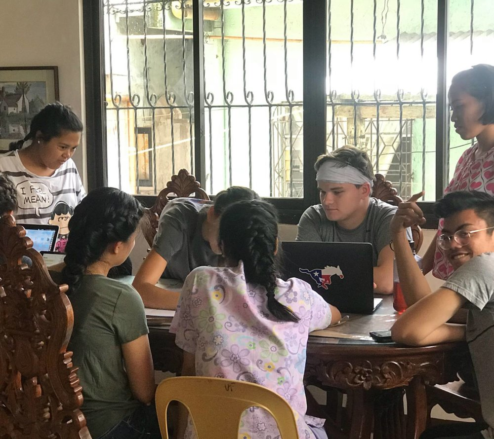 Behind the scenes of programs in the Philippines: Fellows prep curriculum for Youth Health Scouts after first responder training at the Philippines General Hospital.
