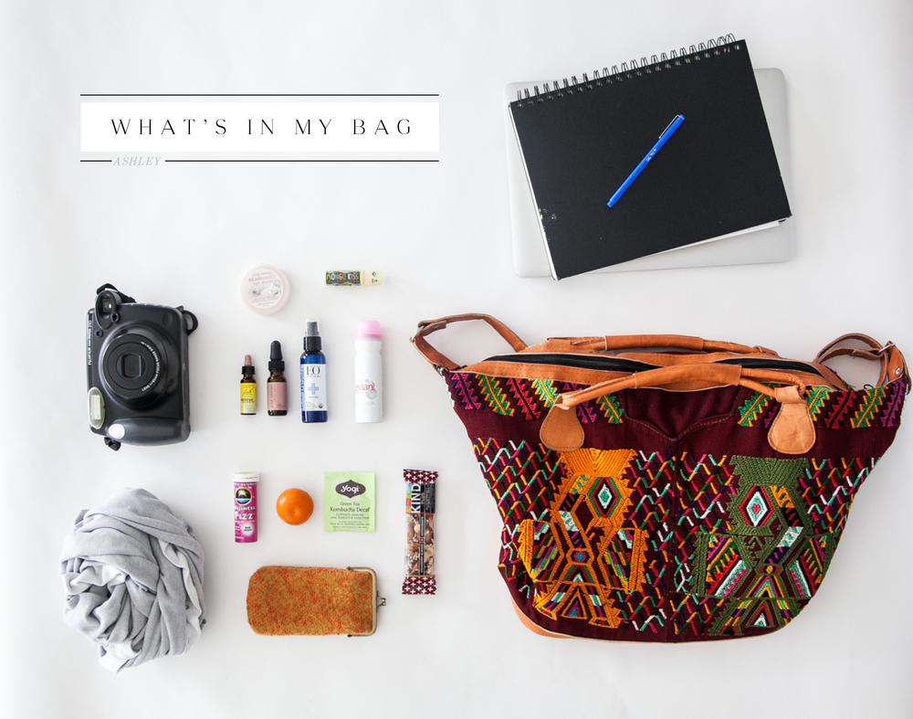 bag / computer / sketchbook / lip balm /  polaroid / stress relief drops / argan oil / spray hand sanitizer / evian spray / tea / wellness tablets / large scarf