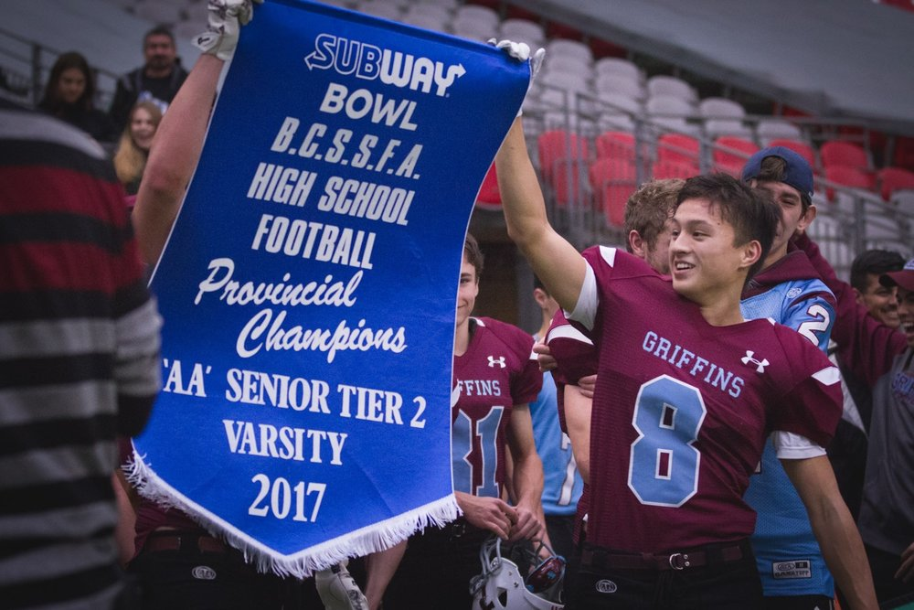 Sebastian Kondratowski holds up the Tier II Championship Banner.jpg