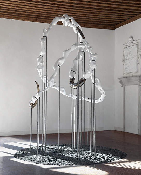 Ashnest, 2011 Mammoth tusks, painted polyurethane, iron rods, resin, ash, bronze slag, sand 170 × 158 inches (432 × 400 cm)
