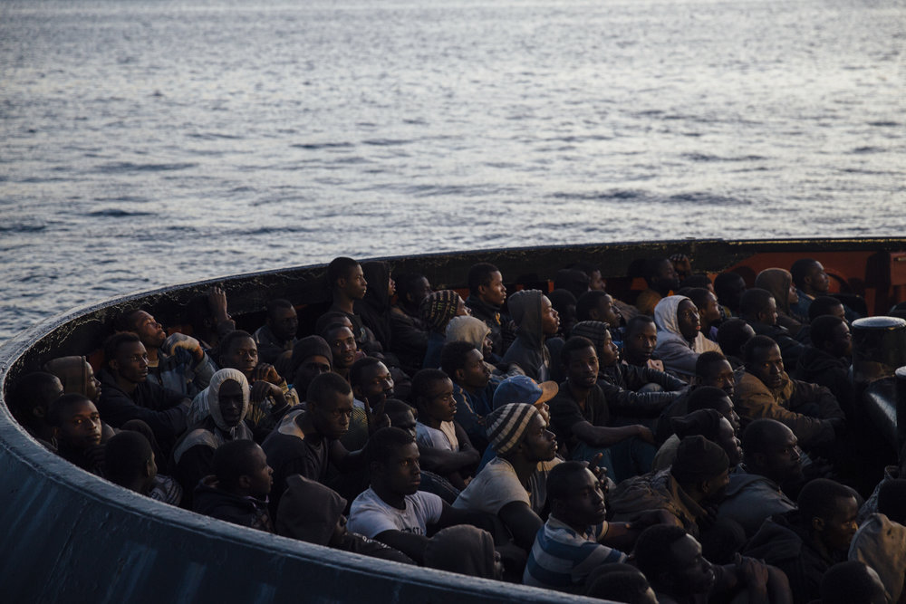 Over 220 refugees wait to step on Italian soil. On June 22nd, a Singaporean ship managed by the Danish shipping company TORM A/S, rescued two boats off the Libyan coast with 221 refugees mostly from West Africa. The southern Italian town of Reggio Calabria saw over 25,000 refugees land in its port between June of 2014 and June of 2015.