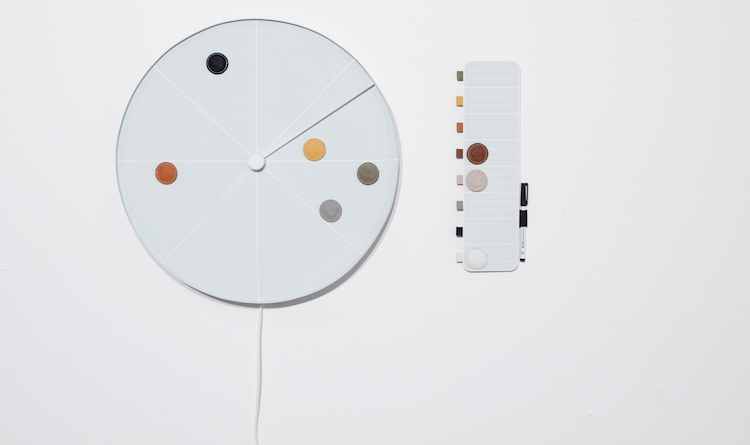 Ingenious clock.. a blank slate where you can place magnents for tasks throughout the day.. beautiful design.