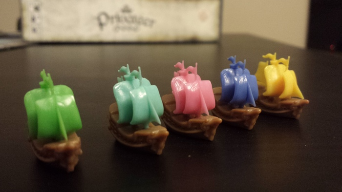 6 player ships in six assorted colors. Each is a custom designed galleon with a width of approximately 1 inch.