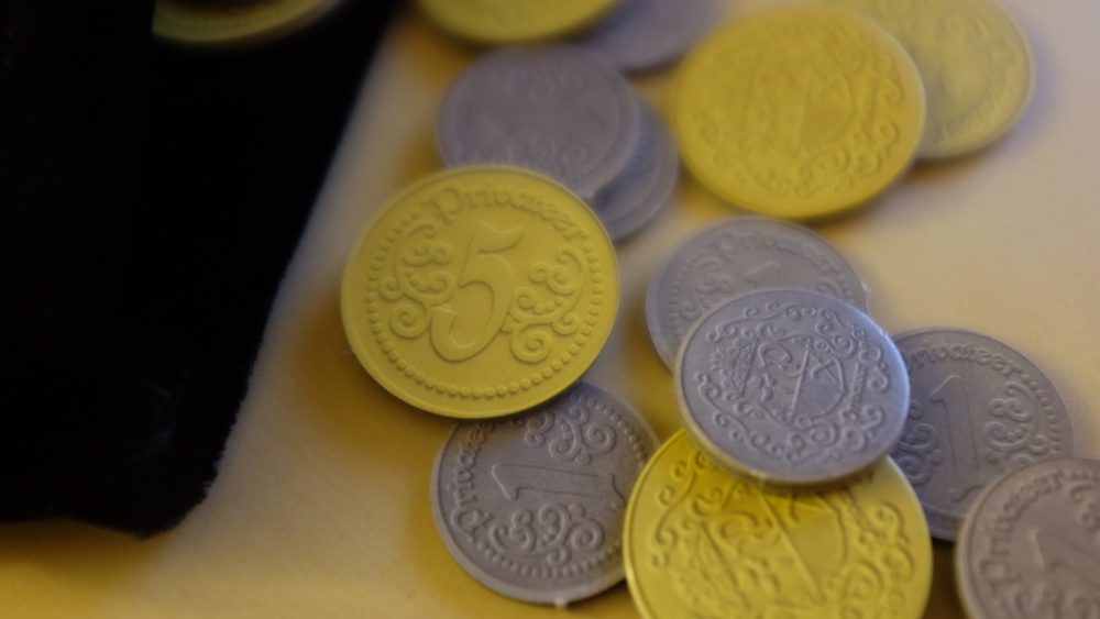 60 custom designed doubloons in two denominations: gold and silver. These coins come with 6 embroidered coin bags for players to conceal their plunder from other players.