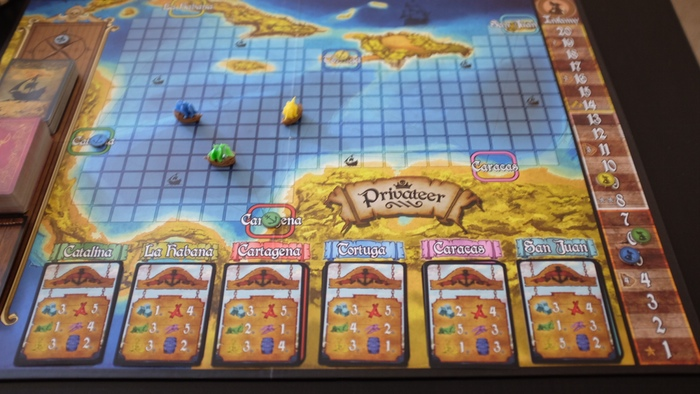 A large, Caribbean inspired game board where players can sail from port to port buying and plundering goods