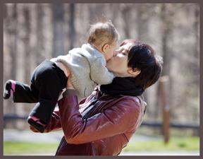 Mom kissing baby - small.jpg
